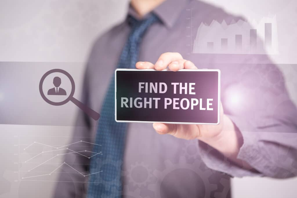 man holding find the right people sign